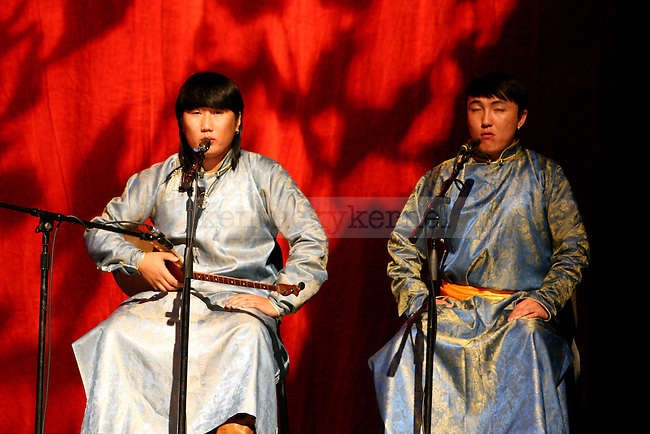 "Two members of the Zhamuqi Band perform ""Hymn of the Heaven"" during  the Arts College of Inner Mongolia University's production ""An Evening of Mongolian Dance and Music"" in the Singletary Center for the Arts at UK  in Lexington, Ky., on Monday, October 29, 2012. Photo by Adam Pennavaria 