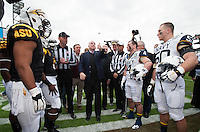 San Francisco, Ca - Saturday, December 29, 2012: Senator John McCain conducts the coin toss using an Oreo Cookie. Arizona State 62-28 over Navy in the Kraft Fight Hunger Bowl at AT&T Park.