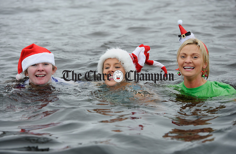 Sinead Reidy, Tracey O Connell and Ciara O Connell during the annual Christmas day swim at Gortglas  Lake, Kildysart in aid of the West Clare Mini Marathon Cancer fund. Photograph by John Kelly.