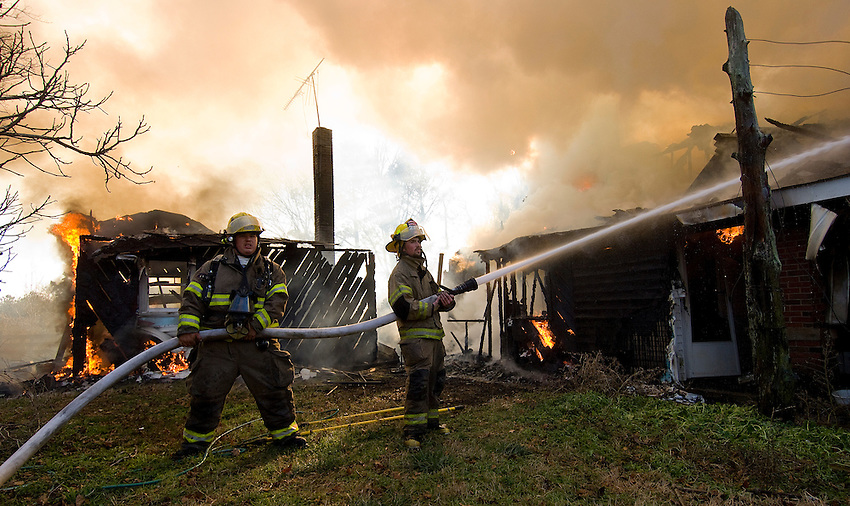 Firefighters from Monrovia and Harvest Volunteer  Fire Departments fight fire at the home of George Hopson at 817 Pettus Road.   Bob Gathany photo..