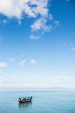 ZANZIBAR, Nungwi Beach, a Fishermen Boat with Passengers on blue turquoise Water