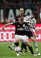 Calcio, Serie A: Milan vs Juventus. Milano, stadio San Siro, 9 aprile 2016. <br /> AC Milan&rsquo;s Juraj Kucka, left, is challenged by Juventus&rsquo; Alvaro Morata during the Italian Serie A football match between AC Milan and Juventus at Milan's San Siro stadium, 9 April 2016.<br /> UPDATE IMAGES PRESS/Isabella Bonotto