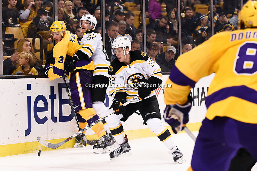Tuesday, February 9, 2016: Boston Bruins defenseman Zach Trotman (62) checks Los Angeles Kings defenseman Brayden McNabb (3) as/ left wing David Pastrnak (88) skates off with the puck during the National Hockey League game between the Los Angeles Kings and the Boston Bruins, held at TD Garden, in Boston, Massachusetts. The Kings defeat the Bruins 9-2. Eric Canha/CSM