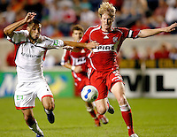 New England Revolution midfielder Clint Dempsey (2) tries to prevent Chicago Fire defender Jim Curtin (5) from getting to the ball.  The Chicago Fire defeated the New England Revolution 2-1 in the quarterfinals of the U.S. Open Cup at Toyota Park in Bridgeview, IL on August 23, 2006...