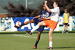9 November 2005: Duke's Darius Barnes (left) plays the ball away from Virginia Tech's Scott Dillie (right). Duke University defeated Virginia Tech 2-0 at SAS Stadium in Cary, North Carolina in a quarterfinal of the 2005 ACC Men's Soccer Championship.