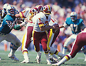 Washington Redskins Joe Theismann (7) in action during a game against the Miami Dolphins at the Orange Bowl in Miami, Florida. Joe Theismann played for the Washington Redskins from 1974-1985.