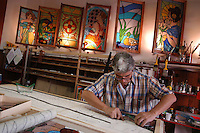 Artigiani a San Lorenzo , quartiere storico di Roma..Craftsmen in San Lorenzo, historic district of Rome. .Aldo Rizzuti mentre prepara le sue vetrate artistiche, nella sua bottega..Aldo Rizzuti while preparing its artistic stained glass, in his workshop..