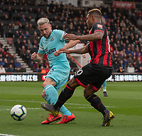Bournemouth's Jordon Ibe (right) is tackled by Newcastle United's Paul Dummett (left) <br /> <br /> Photographer David Horton/CameraSport<br /> <br /> The Premier League - Bournemouth v Newcastle United - Saturday 16th March 2019 - Vitality Stadium - Bournemouth<br /> <br /> World Copyright © 2019 CameraSport. All rights reserved. 43 Linden Ave. Countesthorpe. Leicester. England. LE8 5PG - Tel: +44 (0) 116 277 4147 - admin@camerasport.com - www.camerasport.com