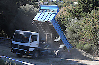 Pictured: A tipper lorry helps special forensics police officers search a field in Kos, Greece. Tuesday 27 September 2016<br /> Re: Police teams searching for missing toddler Ben Needham on the Greek island of Kos have said they are &quot;optimistic&quot; about new excavation work.<br /> Ben, from Sheffield, was 21 months old when he disappeared on 24 July 1991 during a family holiday.<br /> Digging has begun at a new site after a fresh line of inquiry suggested he could have been crushed by a digger.<br /> South Yorkshire Police (SYP) said it continued to keep an &quot;open mind&quot; about what happened to Ben.