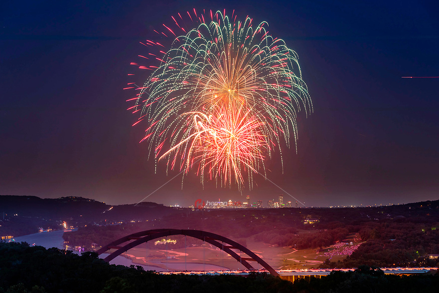 Just a few miles west of the downtown area is Austin's most well known icon, the 360 Bridge. In this image fireworks tower high above the bridge with the Austin skyline in background