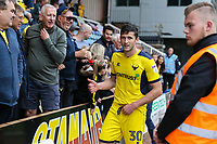 John Mousinho of Oxford United celebrates with supporters after the Sky Bet League 1 match between Peterborough and Oxford United at the ABAX Stadium, London Road, Peterborough, England on 30 September 2017. Photo by David Horn.