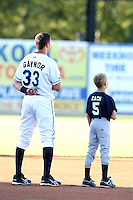 West Michigan Whitecaps third baseman Wade Gaynor (33) with a young fan during a game vs. the South Bend Silver Hawks at Fifth Third Field in Comstock Park, Michigan August 16, 2010.   West Michigan defeated South Bend 3-2.  Photo By Mike Janes/Four Seam Images