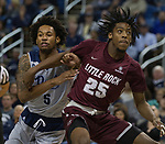 Little Rock forward Horace Wyatt Jr. (25) and Nevada guard Nisre Zouzoua (5) fight for a rebound in the second half of an NCAA college basketball game in Reno, Nev., Friday, Nov. 16, 2018. (AP Photo/Tom R. Smedes)