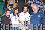 Desmonds Captain Niall Mitchell with his proud family l-r: Katie, Niall and John at the Castleisland Desmonds team homecoming in Castleisland on Saturday night