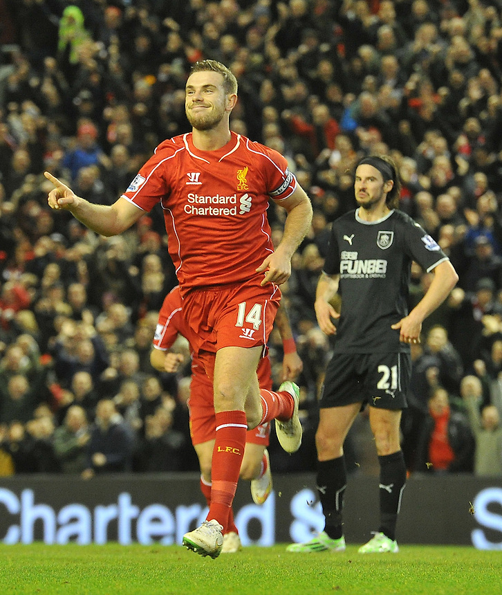 Liverpool's Jordan Henderson celebrates scoring his team's opening goal<br /> <br /> Photographer Dave Howarth/CameraSport<br /> <br /> Football - Barclays Premiership - Liverpool v Burnley - Wednesday 4th March 2015 - Anfield - Liverpool<br /> <br /> &copy; CameraSport - 43 Linden Ave. Countesthorpe. Leicester. England. LE8 5PG - Tel: +44 (0) 116 277 4147 - admin@camerasport.com - www.camerasport.com