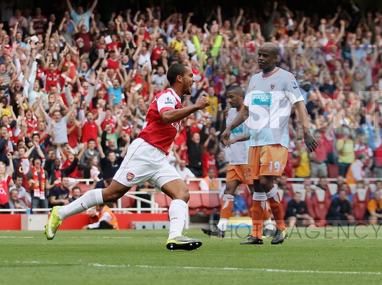 Arsenal's Theo Walcott celebrates scoring his sides opening goal
