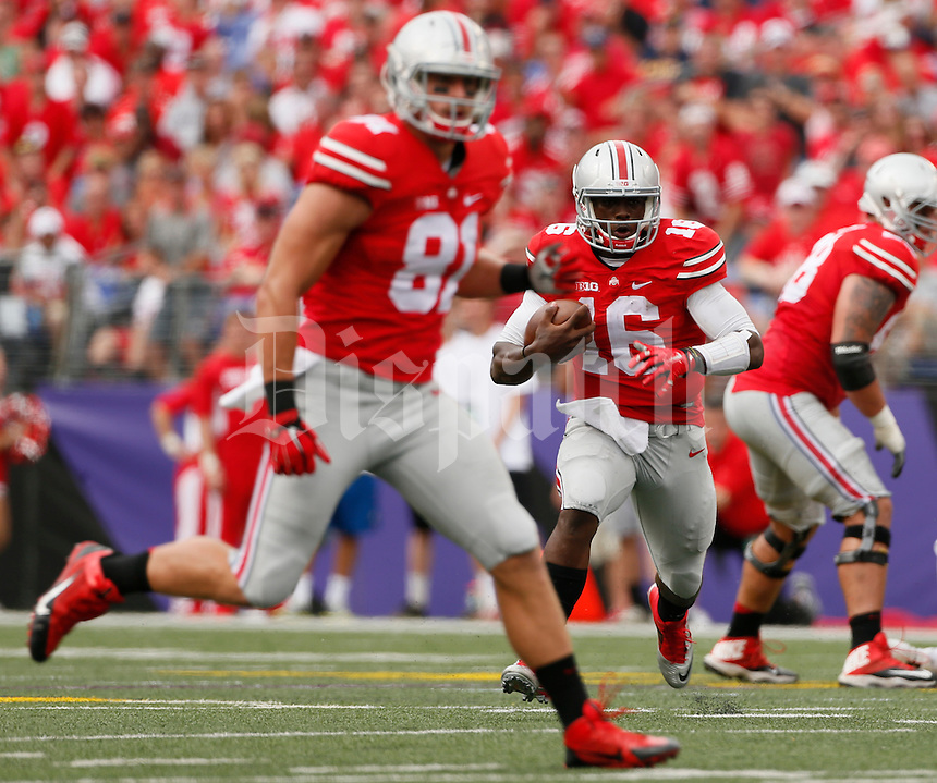 Ohio State Buckeyes quarterback J.T. Barrett (16) runs the football during Saturday's NCAA Division I football game against the Navy Midshipmen at M&T Bank Stadium in Baltimore on August 30, 2014. Ohio State won the game with a final score of 34-17. (Dispatch Photo by Barbara J. Perenic)