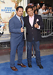 HOLLYWOOD, CA - MARCH 20: Actors Michael Peña (L) and Erik Estrada arrive at the premiere of Warner Bros. Pictures' 'CHiPS' at TCL Chinese Theatre on March 20, 2017 in Hollywood, California.
