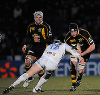 Wycombe, GREAT BRITAIN, Sales' Llee THOMAS, going in low on Richard BIRKETT, during the Guinness Premiership game, London Wasps vs Sale Sharks 15.04.2008 [Mandatory Credit Peter Spurrier/Intersport Images]