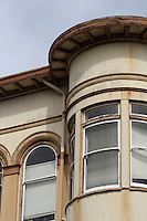 An old building with a curved, cantilevered upper story on 3rd Street in Old Town Eureka in Humboldt County in Northern California.