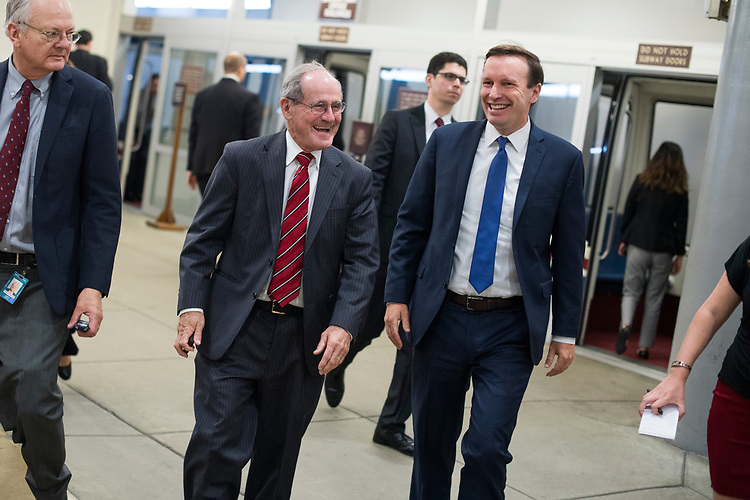 UNITED STATES - JULY 24: Sens. Jim Risch, R-Idaho, left, and Chris Murphy, D-Conn., are seen in the Capitol's Senate subway before the Senate Policy luncheons on July 24, 2018. (Photo By Tom Williams/CQ Roll Call)