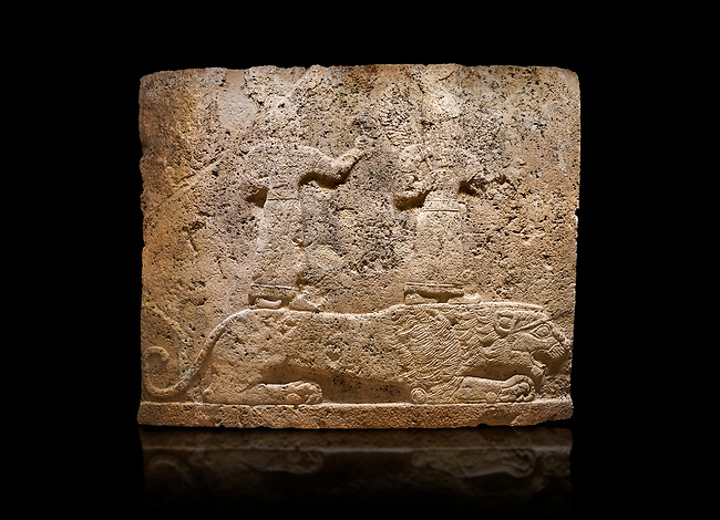 Hittite relief sculpted orthostat stone panel of Long Wall Limestone, Karkamıs, (Kargamıs), Carchemish (Karkemish), 900-700 B.C. Anatolian Civilisations Museum, Ankara, Turkey<br /> <br /> Two figures lying over the lion. There is a crescent at the head of the winged god at the front. It is thought that the figure at the front is moon god and the one at the rear is sun god. <br /> <br /> On a black background.