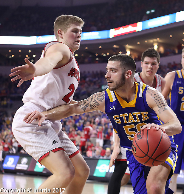SIOUX FALLS, SD: MARCH 6: Michael Orris #50 of South Dakota State drives on Tyler Peterson #22 of South Dakota during the Summit League Basketball Championship on March 6, 2017 at the Denny Sanford Premier Center in Sioux Falls, SD. (Photo by Dick Carlson/Inertia)