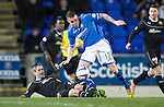 St Johnstone v Motherwell....25.02.14    SPFL<br /> Keith Lasley slides in on James Dunne<br /> Picture by Graeme Hart.<br /> Copyright Perthshire Picture Agency<br /> Tel: 01738 623350  Mobile: 07990 594431