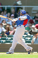 Marlon Byrd #24 of the Chicago Cubs plays against the Arizona Diamondbacks in a spring training game at Salt River Fields on March 13, 2011 in Scottsdale, Arizona. .Photo by:  Bill Mitchell/Four Seam Images.