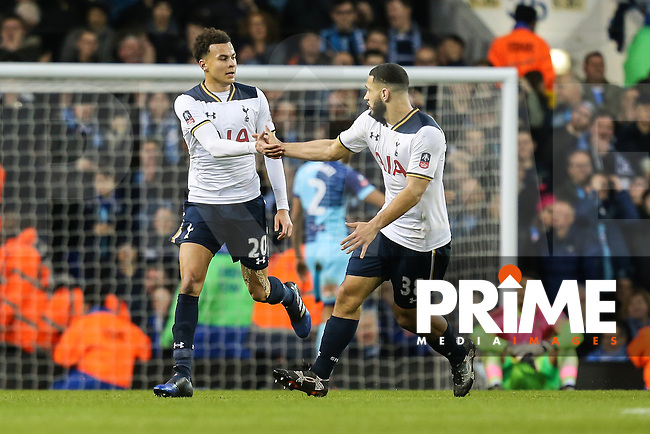 Dele Alli of Tottenham Hotspur celebrates with Cameron Carter-Vickers of Tottenham Hotspur (right) after he scores his team's third goal of the game to make the score 3-3 during the FA Cup 4th round match between Tottenham Hotspur and Wycombe Wanderers at White Hart Lane, London, England on 28 January 2017. Photo by PRiME Media Images / David Horn.