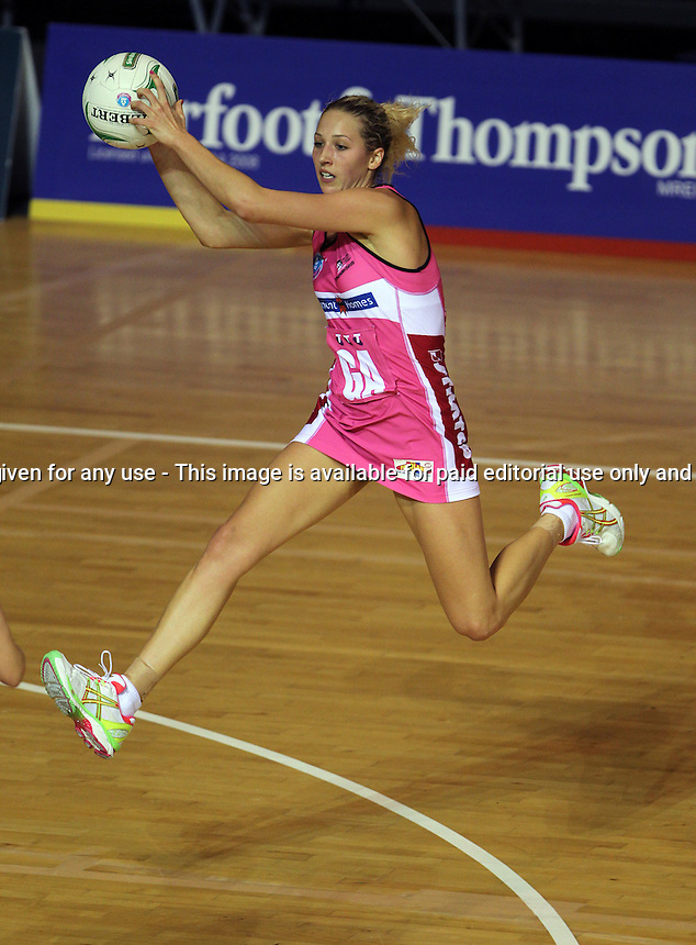 22.04.2012 Thunderbirds Erin Bell in action during the ANZ Champs netball match between the Mystics and Thunderbirds played at Trusts Stadium in Auckland. Mandatory Photo Credit ©Michael Bradley.