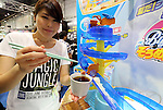 "June 9, 2016, Tokyo, Japan - An employee of Japanese toy maker Tomy displays a 3.6m long flowing noodles toy ""Big Stream Somen slider"" at the annual Tokyo Toy Show in Tokyo on Thursday, June 9, 2016. Some 160,000 people are expecting to visit the four-day toy trade show.   (Photo by Yoshio Tsunoda/AFLO) LWX -ytd-"