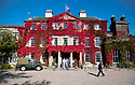 """09/10/18<br /> <br /> Surrounded by stunning autumnal colours on Bishton Hall's Virginia Creeper, potential bidders arrive to view lots ahead of the contents of the quintessentially British house being auctioned. Included in sale is the 1958 series one Land Rover parked outside the hall that belonged to the hall's owners who ran St Bedes School  from the property near Rugeley, Staffordshire, for many years . The school and hall have now been sold and its future is unknown. <br /> <br /> The contents will be auctioned on Saturday, Monday and Tuesday by Hansons Auctioneers.<br /> <br /> One man who was a boarder at the school from the age of five, and who hadn't been back for thirty years came to view the sale items and said: """"I'll probably buy a desk or something. I'm not sure if I'll cherish it or want to blow it up.  The hall hasn't changed at all - it even smells just the same as it did years ago.""""<br /> <br /> <br /> All Rights Reserved, F Stop Press Ltd. (0)1335 344240 +44 (0)7765 242650  www.fstoppress.com rod@fstoppress.com"""