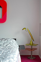 Close up of a designer bedside lamp in the bedroom