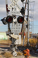 A vintage  railroad crossing signal still in operation in industrial Detroit, USA. Railroads have been vital in the history of the population and trade of rough and finished goods in the state of Michigan. While some coastal settlements had previously existed, the population, commercial, and industrial growth of the state further bloomed with the establishment of the railroad.<br /> The state's proximity to Ontario, Canada aided the transport of goods in a smooth east-west trajectory from the eastern shore of Lake Michigan toward Montreal and Quebec.<br /> Major railroads in the state, prior to 20th century consolidations, had been the Michigan Central Railroad and the New York Central Railroad.