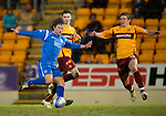 St Johnstone v Motherwell....26.01.11  .Stevie May closed down by Shaun Hutchinson and Jamie Murphy.Picture by Graeme Hart..Copyright Perthshire Picture Agency.Tel: 01738 623350  Mobile: 07990 594431