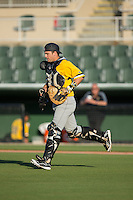 Taylor Gushue (17) of the West Virginia Power jogs out to the mound during the game against the Kannapolis Intimidators at CMC-Northeast Stadium on April 21, 2015 in Kannapolis, North Carolina.  The Power defeated the Intimidators 5-3 in game one of a double-header.  (Brian Westerholt/Four Seam Images)