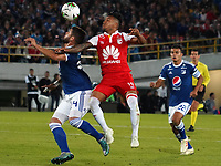 BOGOTÁ - COLOMBIA, 15-01-2019: Mati­as de los Santos (Der) Jugador de Millonarios, disputa balón con Wilson Morelo (Izq) jugador del Independiente Santa Fe, durante partido entre Independiente Santa Fe y Millonarios, por el Torneo Fox Sports 2019, jugado en el estadio Nemesio Camacho El Campin de la ciudad de Bogotá. / Mati­as de los Santos (R) player of Millonarios vies for the ball with Wilson Morelo (L) Player of Independiente Santa Fe during a match between Independiente Santa Fe and Millonarios, for the Fox Sports Tournament 2019, played at the Nemesio Camacho El Campin stadium in the city of Bogota. Photo: VizzorImage / Diego Cuevas / Cont