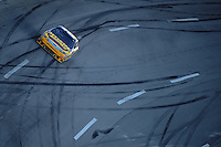 Nov. 1, 2009; Talladega, AL, USA; NASCAR Sprint Cup Series driver Jamie McMurray drives through the tri-oval covered with skid marks following a crash coming to the last lap during the Amp Energy 500 at the Talladega Superspeedway. Mandatory Credit: Mark J. Rebilas-