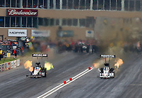 Jul. 19, 2014; Morrison, CO, USA; NHRA top fuel driver Antron Brown (right) races alongside Terry McMillen during qualifying for the Mile High Nationals at Bandimere Speedway. Mandatory Credit: Mark J. Rebilas-