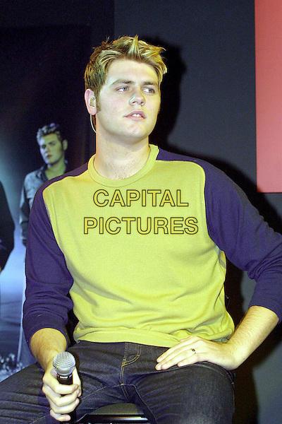 WESTLIFE - Brian MCFADDEN<br /> green top, blue sleeves, half length, half-length<br /> www.capitalpictures.com<br /> sales@capitalpictures.com<br /> &copy; Capital Pictures
