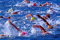 Swimmers compete in the grueling swim event at the annual Ironman Triatholon on the Big Island of Hawaii.