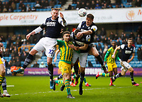 9th February 2020; The Den, London, England; English Championship Football, Millwall versus West Bromwich Albion; Matt Smith of Millwall heads the ball away with Aiden O'Brien and Murray Wallace of Millwall blocking Hal Robson-Kanu of West Bromwich Albion from a corner