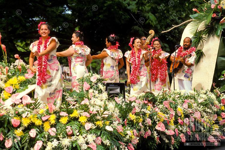 women dancing hula on float in Aloha Festivals Parade, Honolulu
