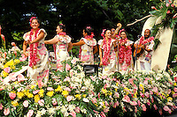 women dancing hula on float in Aloha Festivals Parade, Honolulu