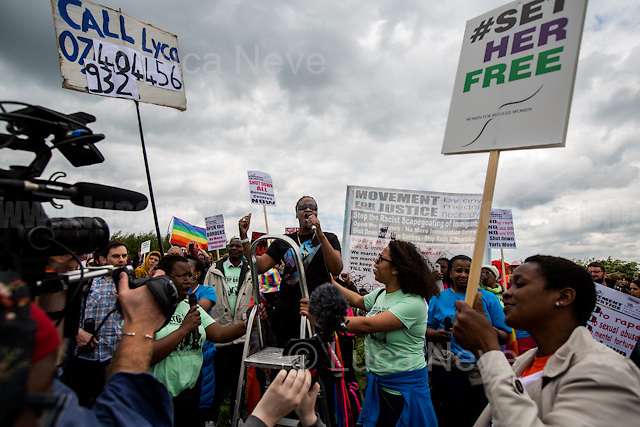Yarl's Wood former detainee. <br /> <br /> Bedford (Bedfordshire, England), 13/05/2017. Today, more than two thousand activists and members of the public from across the UK gathered outside the notorious Yarl's Wood I.R.C. Immigration Removal Centre in Bedfordshire, lead by the &quot;Movement for Justice By Any Means Necessary&quot; to protest against the alleged inhuman conditions of the 400+ detainees (showed in a Channel 4 undercover investigation - http://bit.ly/1E6X4pz) and to call for immediate closure of all detention centres. &lt;&lt;Yarl's Wood Immigration Removal Centre is a detention centre for foreign nationals prior to their deportation from the United Kingdom, one of 13 such centres currently in the UK. It is located near Milton Ernest in Bedfordshire, England, and is operated by Serco (British outsourcing company based in Hook, Hampshire. It operates public and private transport and traffic control, aviation, military weapons, detention centres, prisons and schools on behalf of its customers - Source Wikipedia.org), who describes the place as &quot;a fully contained residential centre housing adult women and adult family groups awaiting immigration clearance.&quot; Its population is, and has been, overwhelmingly female. [&hellip;] &gt;&gt; (Source - Wikipedia.org at http://bit.ly/1GiTFWB). The protest of today was the 11th demo organised at Yarl's Wood and the largest ever at a detention centre in the UK. Mabel Gawanas, 43 - the longest-serving detainee at Yarl's Wood: three years - attended the demo, gave a speech and chatted on the phone offering her support and solidarity with the people detained (For an article about Mabel Gawanas please click here: https://goo.gl/3JCTCB - Source, Bedfordshire On Sunday).<br /> <br /> For more information please click here: https://www.facebook.com/events/1397760473581688/&amp; http://www.movementforjustice.org/ &amp; https://twitter.com/followMFJ