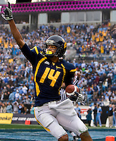 West Virginia wide receiver Bradley Starks (14) celebrates a touchdown against North Carolina during the Meineke Car Care Bowl college football game at Bank of America Stadium in Charlotte, NC.