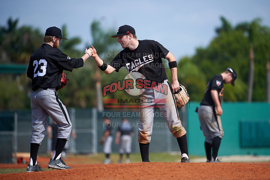 Edgewood Eagles Jonathan Roehler (9) fist bumps pitcher Ryan Howell (23) during the first game of a doubleheader against the Lasell Lasers on April 14, 2016 at Terry Park in Fort Myers, Florida.  Edgewood defeated Lasell 9-7.  (Mike Janes/Four Seam Images)