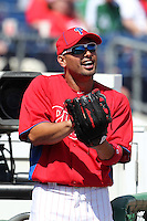 Philadelphia Phillies outfielder Shane Victorino #8 jokes around before a spring training game against the Houston Astros at Bright House Field on March 7, 2012 in Clearwater, Florida.  (Mike Janes/Four Seam Images)