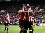 Leon Clarke of Sheffield Utd celebrates his second goal with the provider Billy Sharp and Chris Basham of Sheffield Utd during the English League One match at Bramall Lane Stadium, Sheffield. Picture date: April 17th 2017. Pic credit should read: Simon Bellis/Sportimage